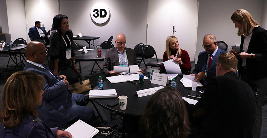 Liz Sara, a Dingman Angel (standing left) and Holly DeArmond, Interim Managing Director of Dingman Center of Entrepreneurship (standing right) moderated the judges' deliberation.