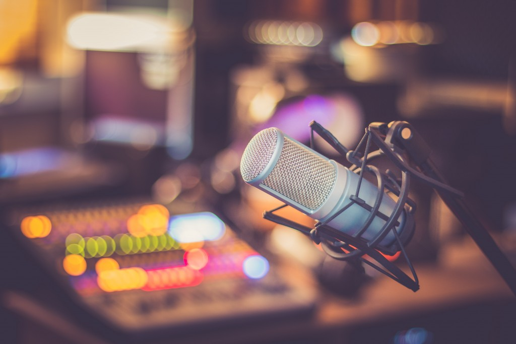 Microphone in a professional recording or radio studio, equipment in a radio stiation blurry background