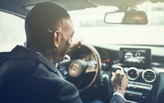 Man listening to radio in car
